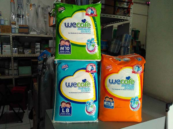 we care pampers M-L-XL